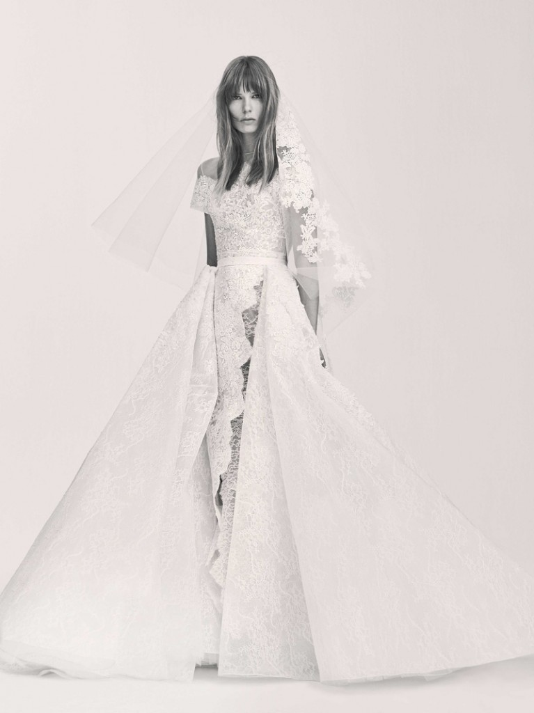 Sacks Productions_Favorite Looks_elie saab at #bridalfashionweek - Long lace short-sleeved dress with slit at front. Fully embroidered with bouquet Guipure. Removable lace skirt embroidered with Guipure appliqué.